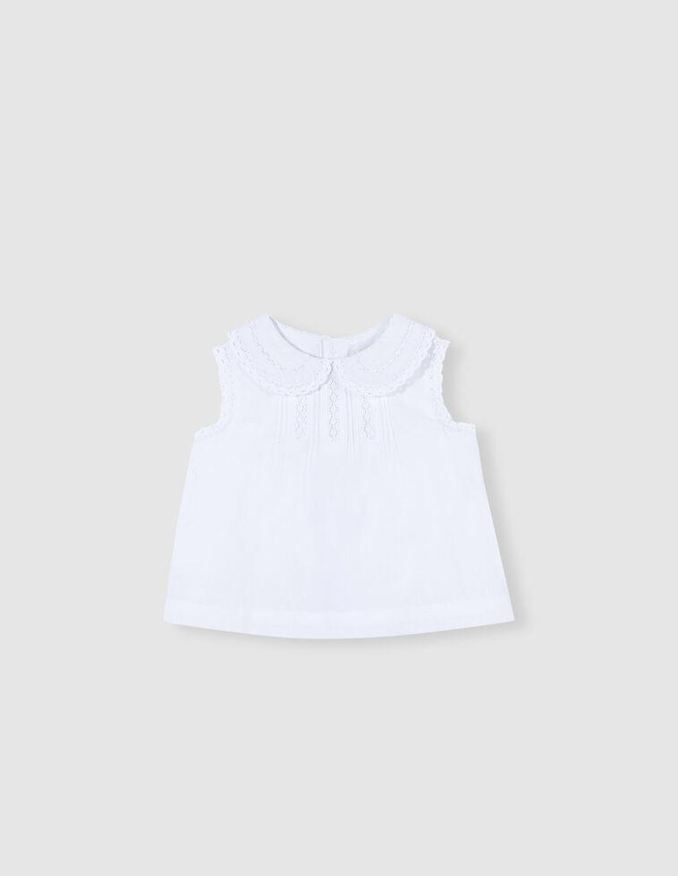 Camisa branca com tiras bordadas